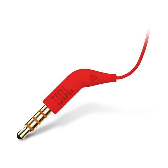 JBL TUNE 110 - Red - In-ear headphones - Detailshot 1